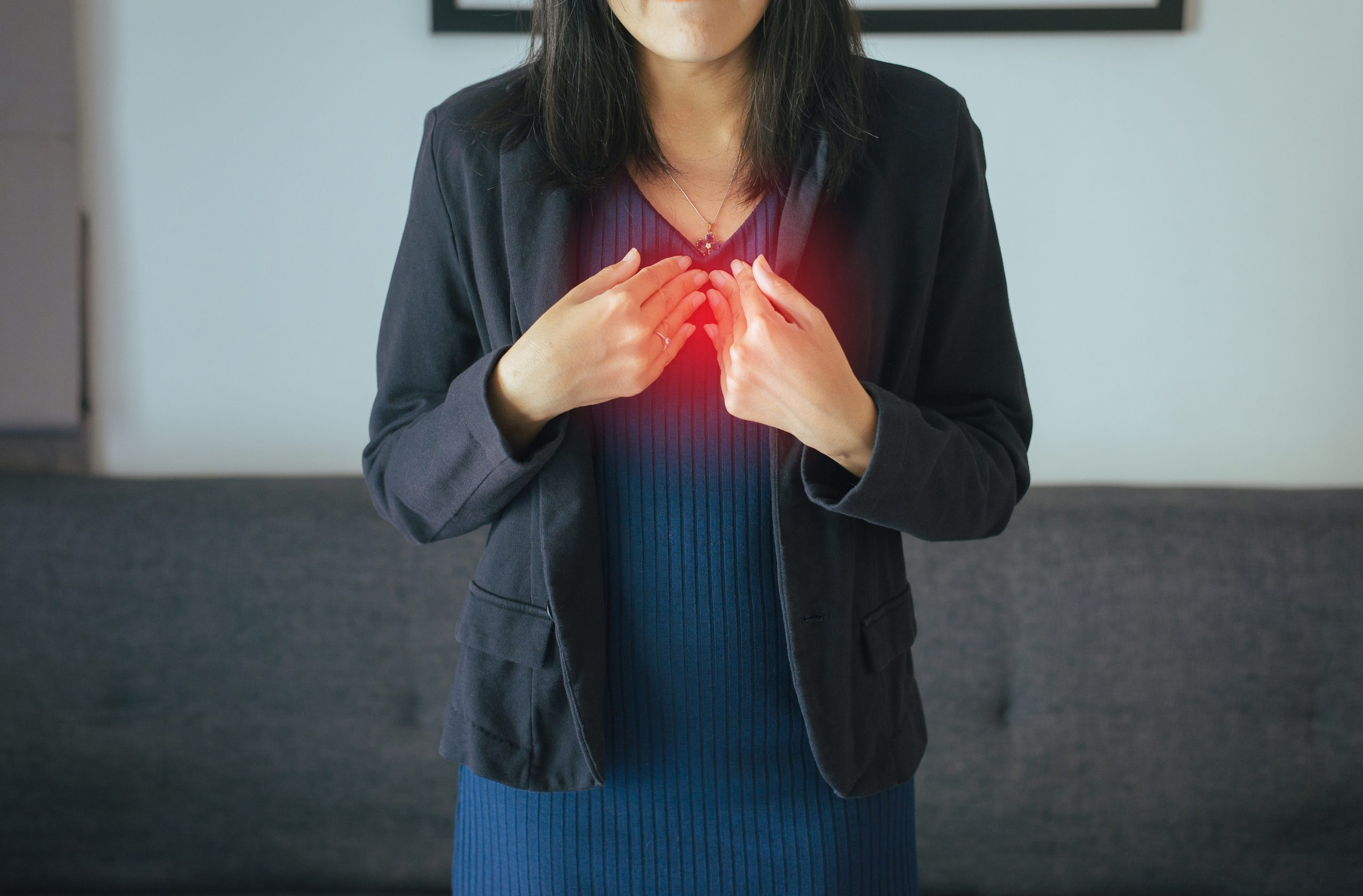 Asian woman having or symptomatic reflux acids