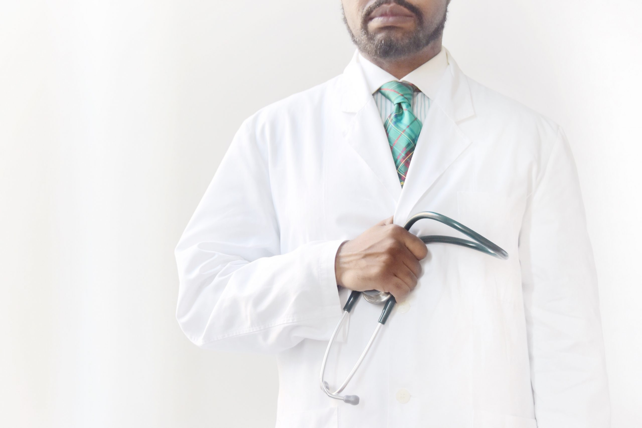 Medical professional standing with stethoscope