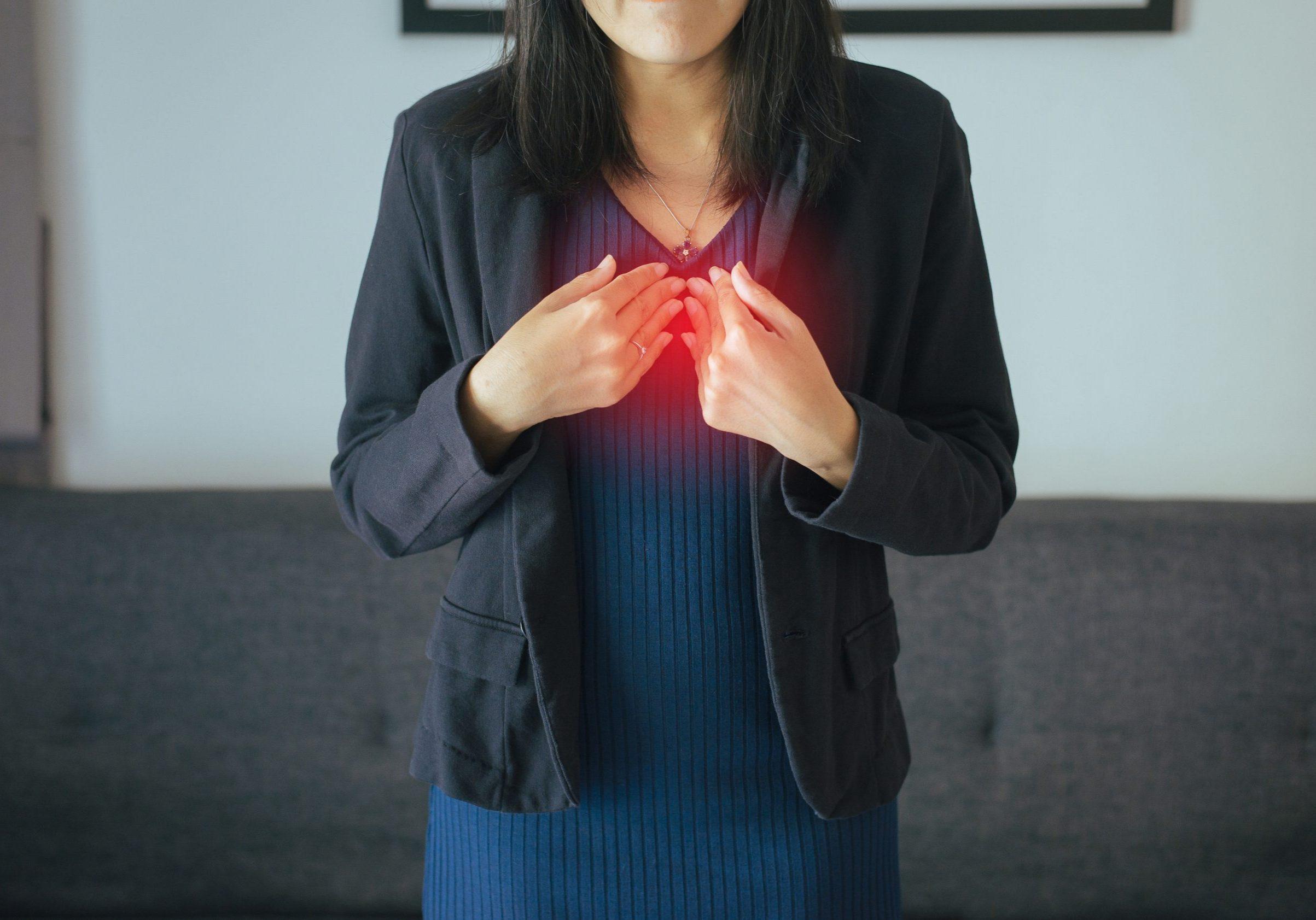 Asian woman having or symptomatic reflux acids