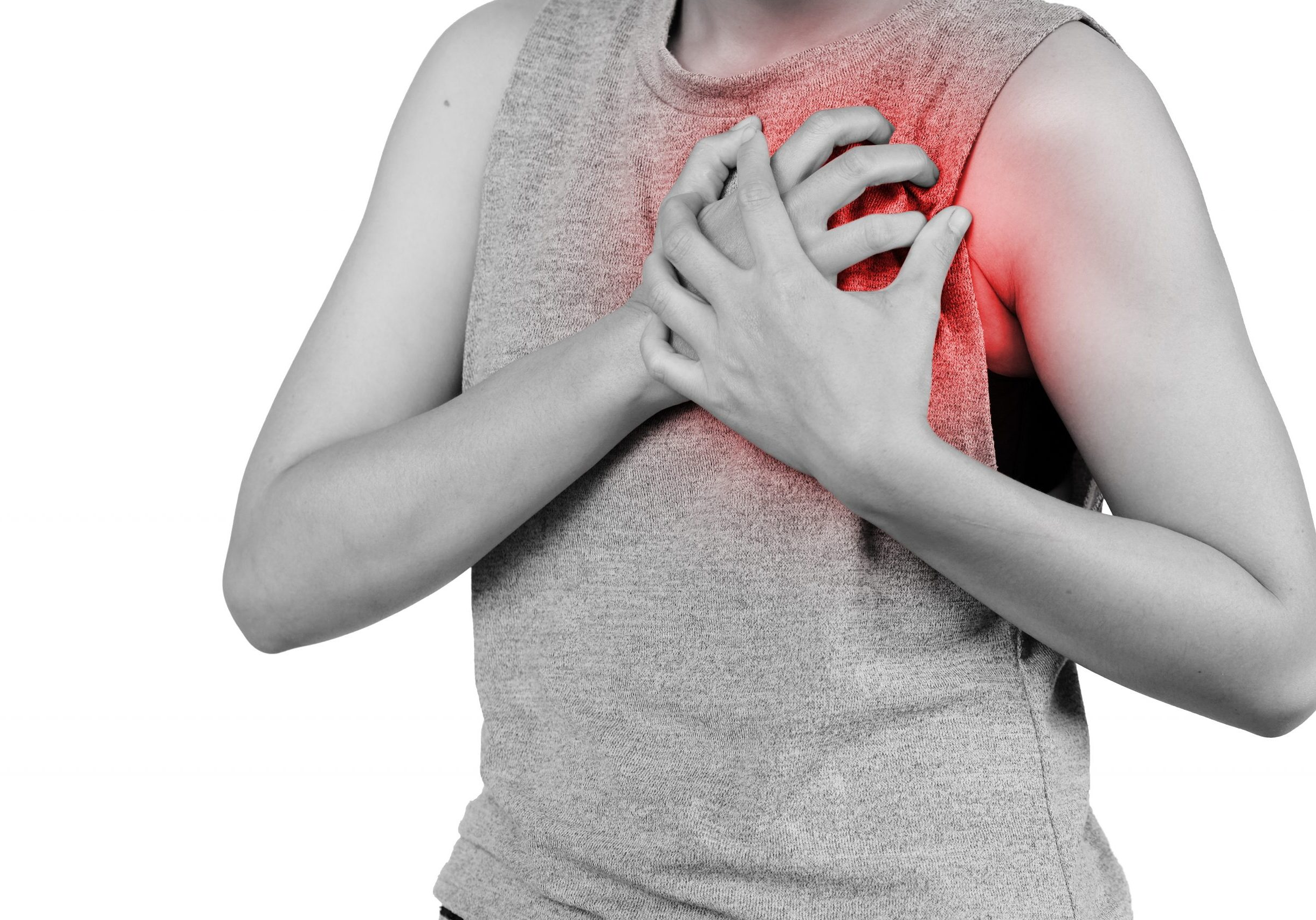 woman clutching his chest from acute pain